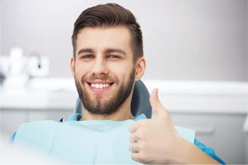 Man smiling with thumb's up