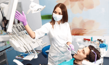 A dentist performing an oral exam