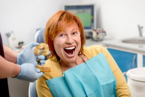 woman smiling looking at new teeth